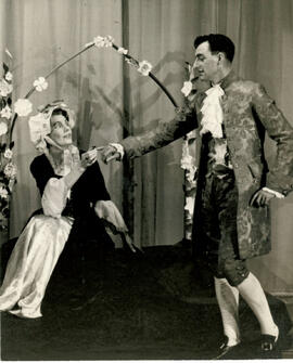 Unnamed play E, two cast members and garland arch, [no date].