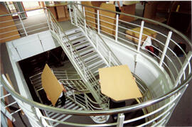 Tables on mezzanine stairs.
