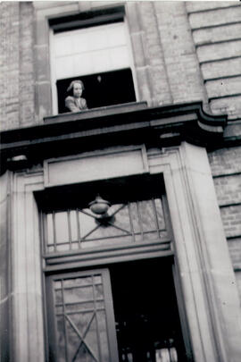 Kathleen Dickenson at the window of her room above the entrance of Macaulay Hall 1947