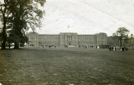 Education Block and lawn, with tree and band in background.