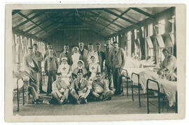 Wounded soldiers and nurses. Postcard.