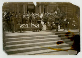 King George and Queen Mary presenting medals for gallantry to wounded soldiers. Photograph. (big blot)